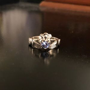 Silver Claddagh ring with blue stone